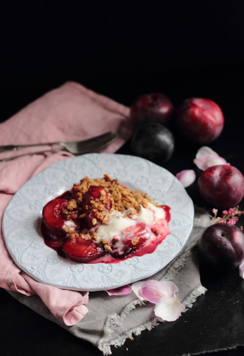 Poached vanilla and cardamon plums with oat crumble