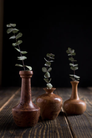 Three turned wooden vases